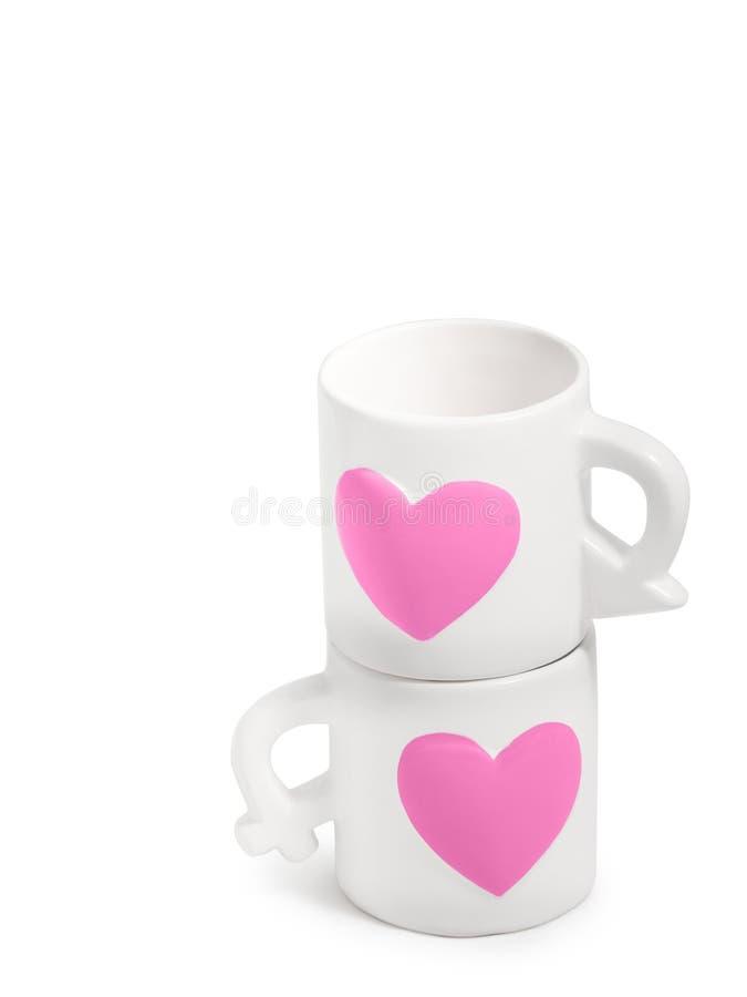 Чашки милых пар керамические на белой ясной изолированной предпосылке, pi стоковое фото