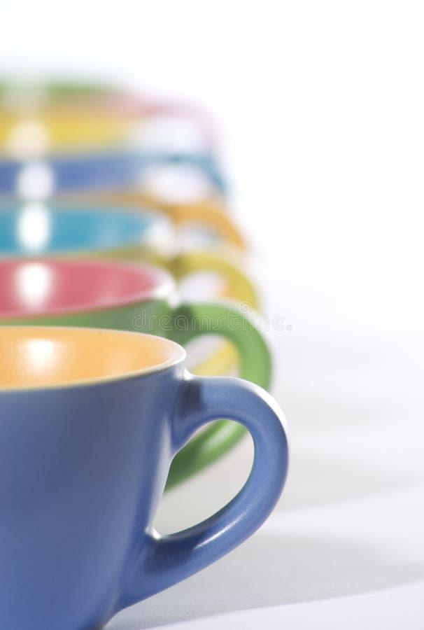 чашки покрашенные кофе стоковые изображения rf
