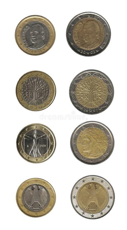 чеканит евро изолированное над белизной стоковая фотография rf