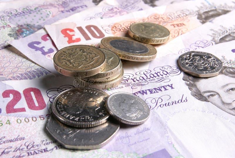 чеканит примечания Великобританию дег валюты Редакционное Стоковое Изображение