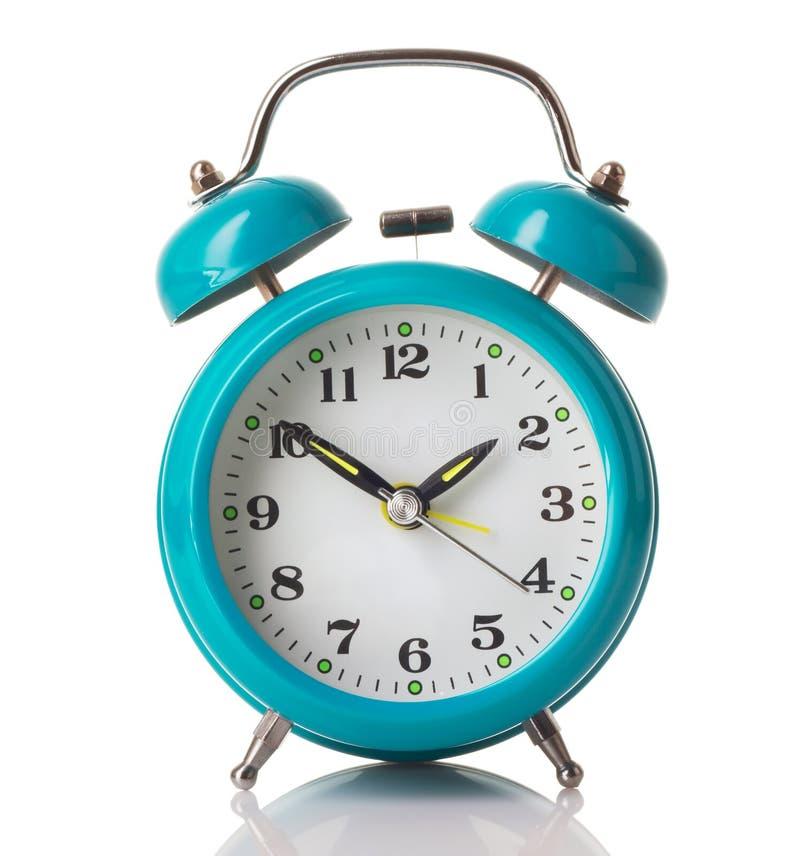 Чеканьте зеленый будильник стоковые фотографии rf