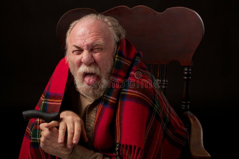человека язык ручек вне старший несчастный стоковая фотография rf