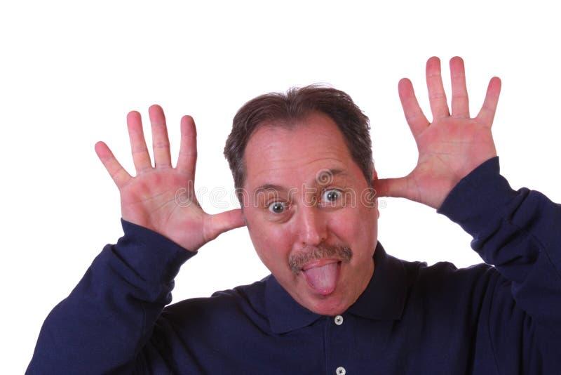 человек вне вставляя язык стоковое изображение