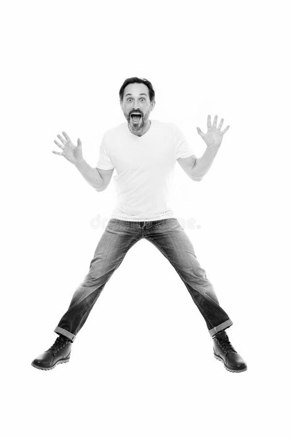 Человек возбудил скакать Зрелый харизматический диктор возбужденный для того чтобы сообщить Вполне ободрения Счастливый эмоционал стоковые фотографии rf