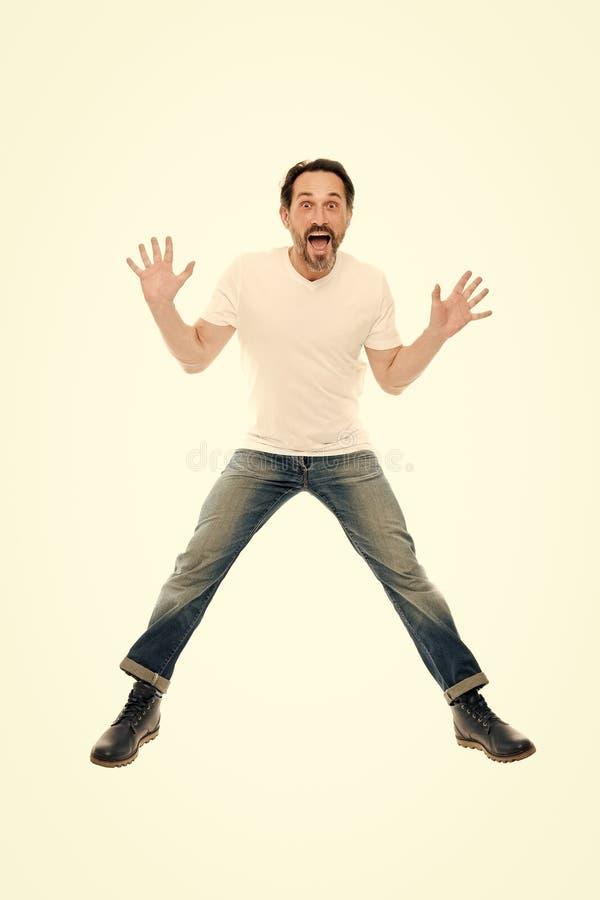 Человек возбудил скакать Зрелый харизматический диктор возбужденный для того чтобы сообщить Вполне ободрения Счастливый эмоционал стоковое фото rf