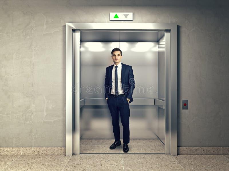 Человек в лифте стоковые фотографии rf