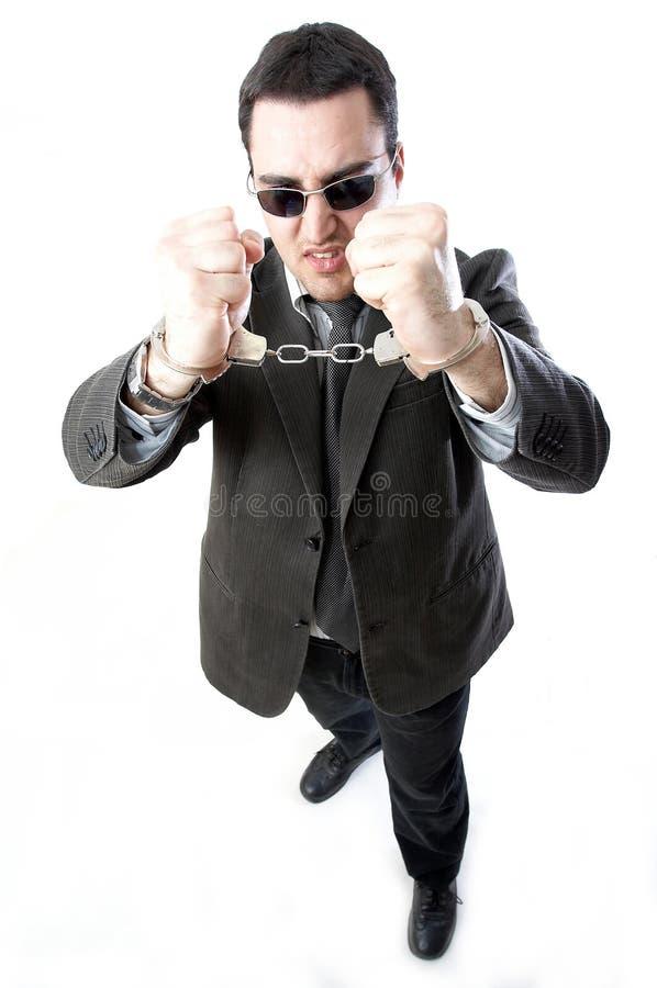 Человек в наручниках стоковое фото