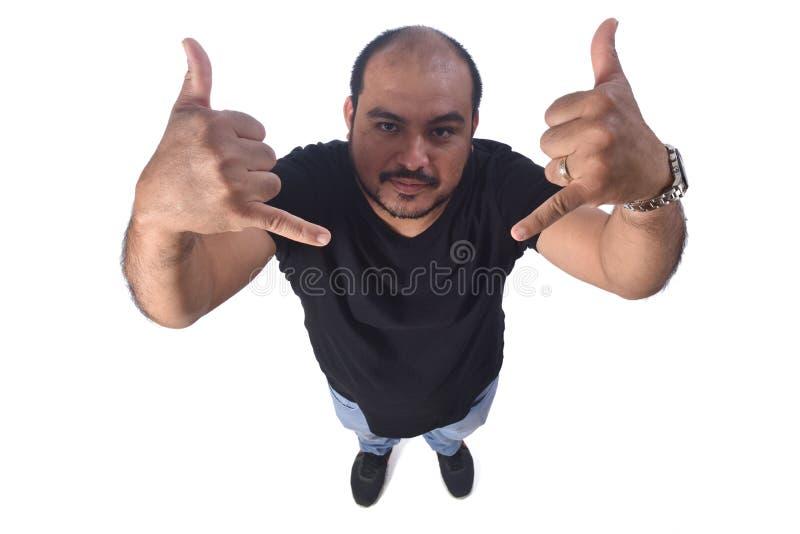 Человек делая рожки на белой предпосылке стоковые фотографии rf