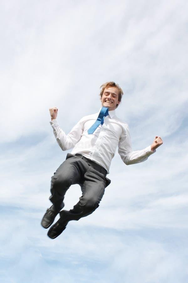 человек дела скача стоковое изображение rf