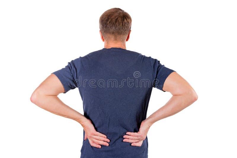 Человек держа его тягостную воспламененную поясницу на белой предпосылке Здравоохранение и микстура Страдать от боли в спине стоковая фотография