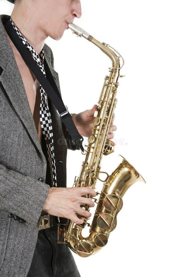 человек джаза играет саксофон стоковое изображение rf