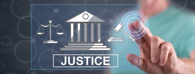 Человек касаясь концепции правосудия стоковое изображение
