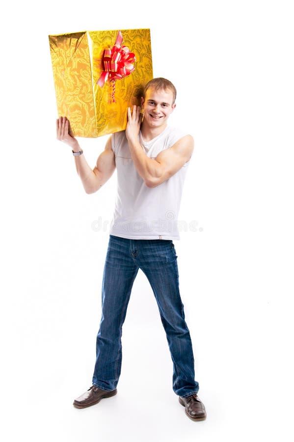 Download человек подарка стоковое изображение. изображение насчитывающей яркое - 6856167