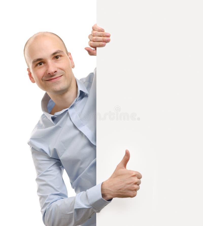 Человек при пустое знамя показывая большие пальцы руки поднимает жест стоковое изображение