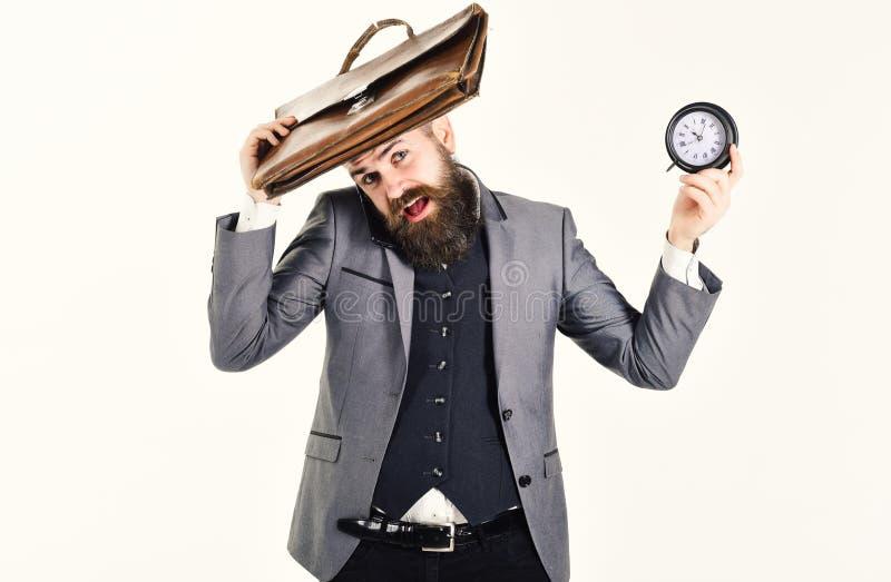 Человек при часы и портфель изолированные на белизне стоковое фото rf