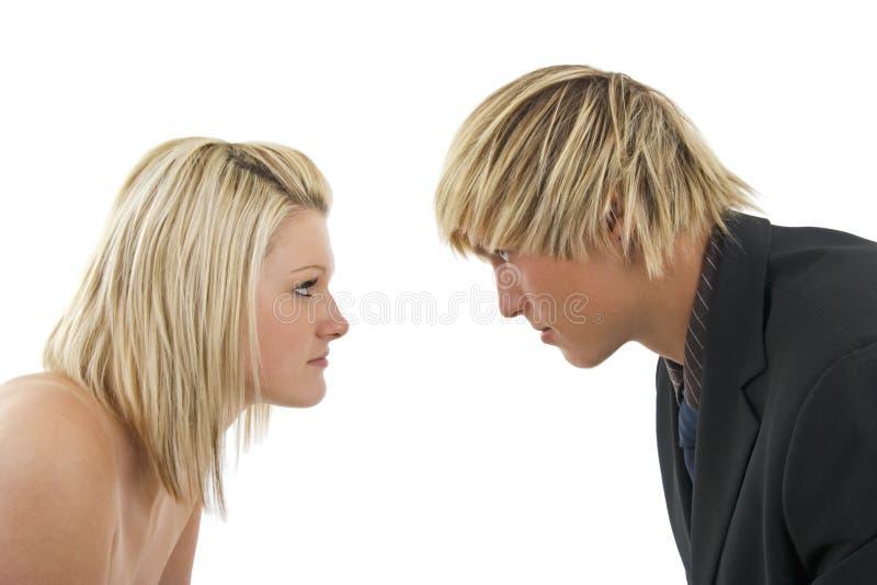 человек против женщины стоковая фотография rf