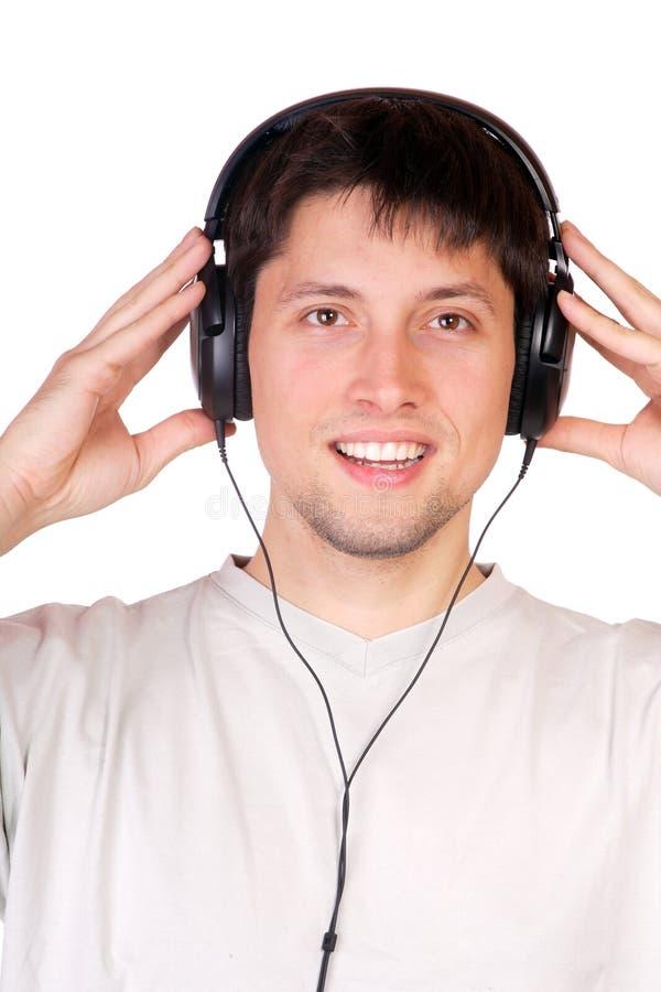 Человек слушает к нот стоковые фотографии rf