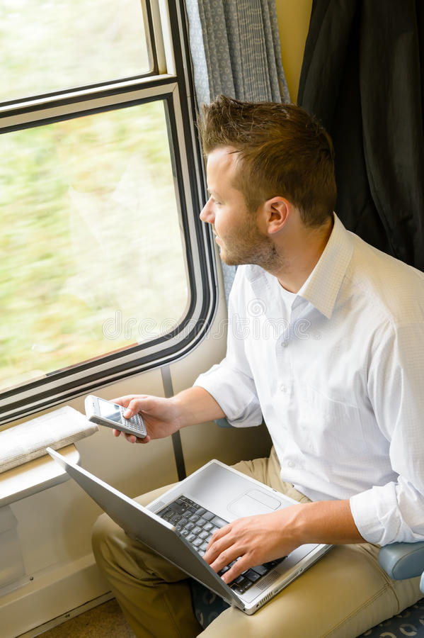 Человек смотря вне думать окна поезда стоковое фото rf