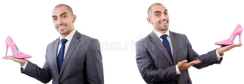 Человек с ботинками изолированными на белизне стоковые изображения