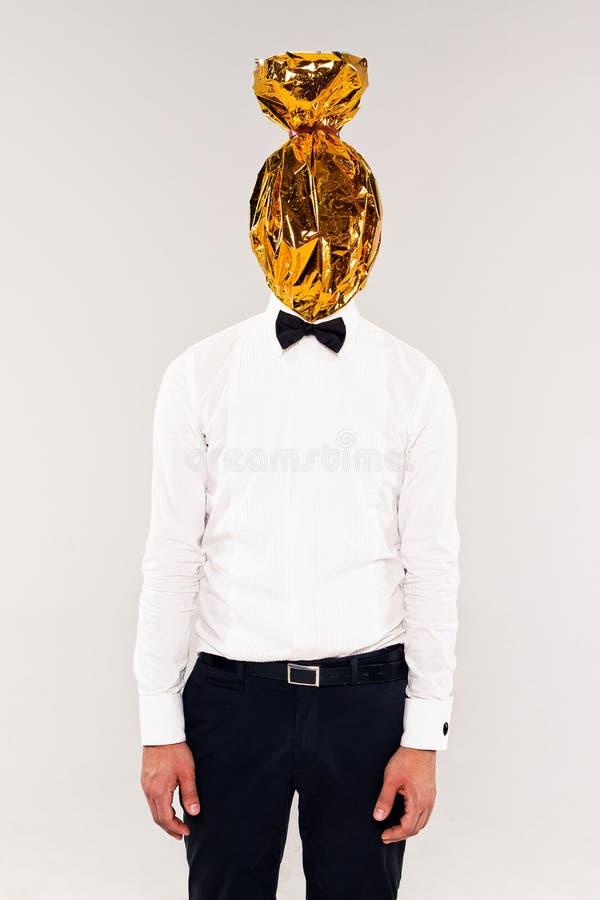 Человек с головкой конфеты стоковые фото