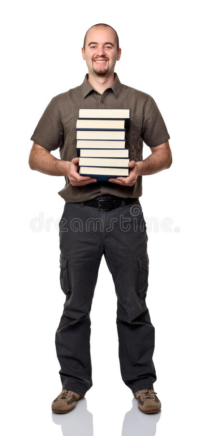 Человек с книгами стоковые изображения