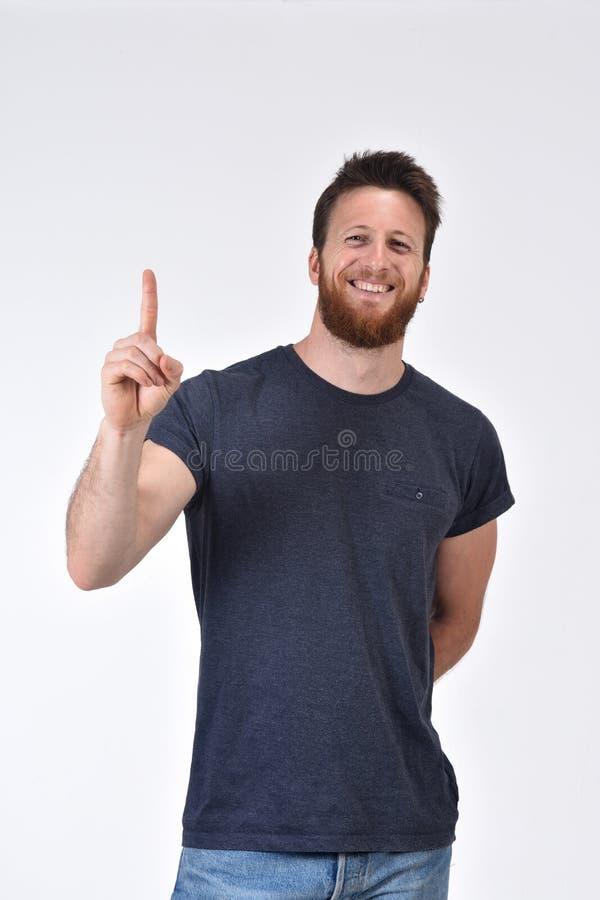 Человек с пальцем в форме одно стоковые изображения rf