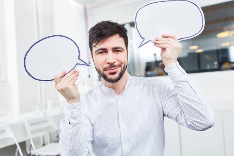 Человек с пузырями речи стоковое фото