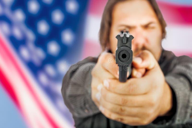 Человек с пушкой стоковое изображение rf