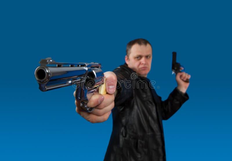 Человек с пушкой стоковое фото