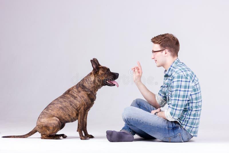 Человек с собакой стоковые фото