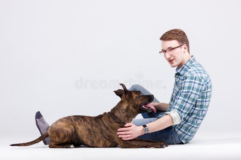 Человек с собакой стоковое фото