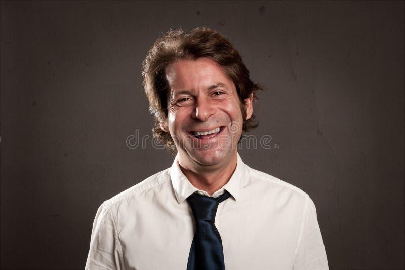 Человек с счастливым выражением стоковая фотография