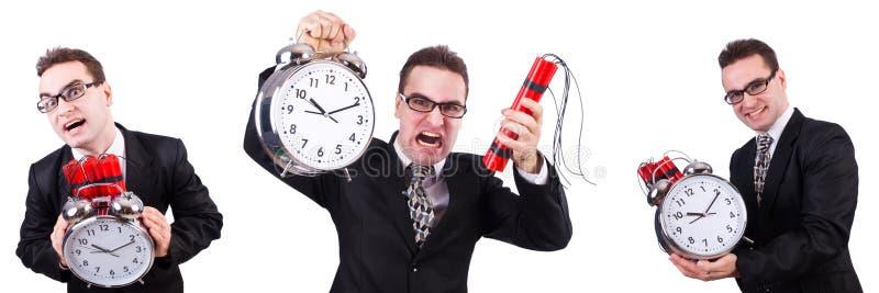 Человек с часовой бомбой изолированной на белизне стоковое изображение rf