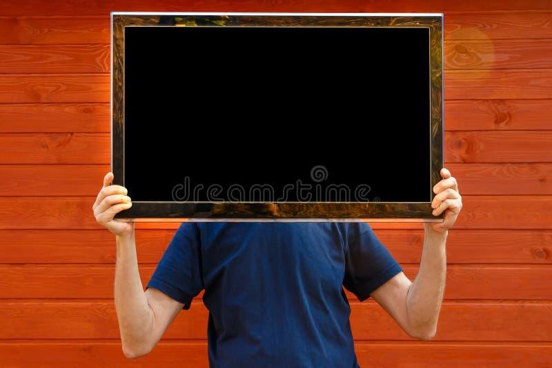 Человек ТВ ТВ вместо головы стоковые изображения