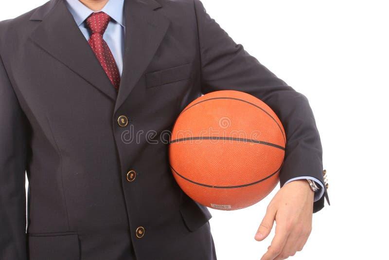 человек удерживания дела баскетбола шарика стоковые изображения
