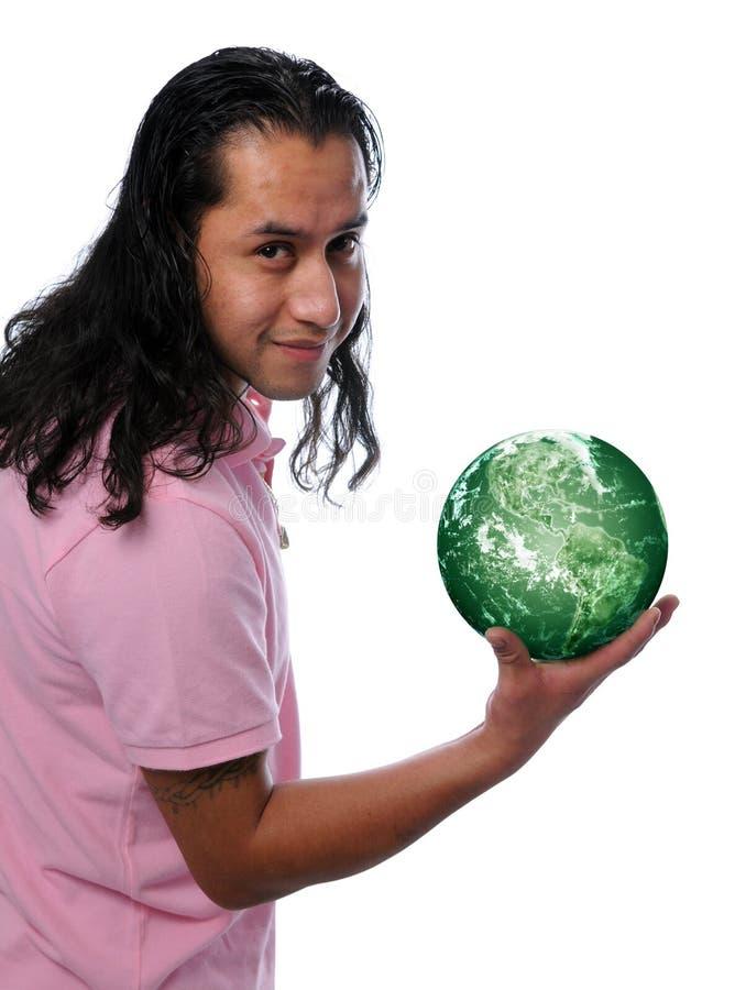 человек удерживания земли зеленый испанский стоковое фото