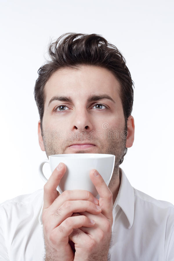 человек удерживания кофейной чашки стоковое фото