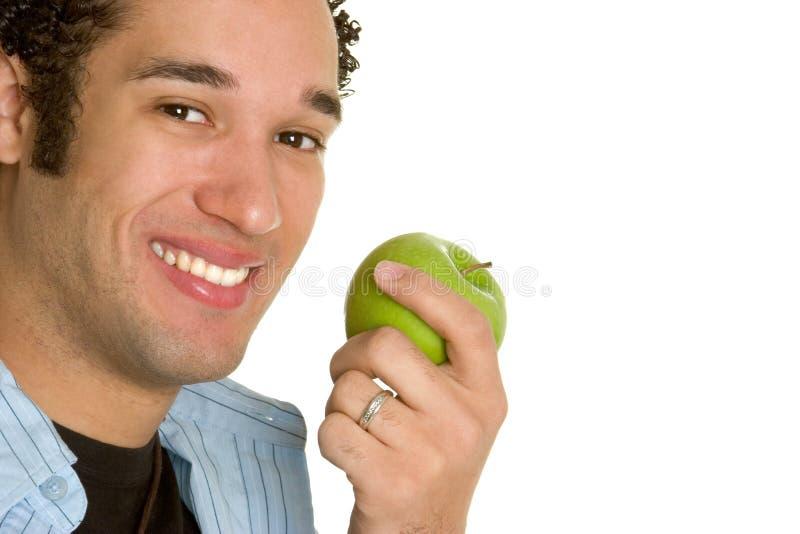 человек удерживания яблока стоковое фото
