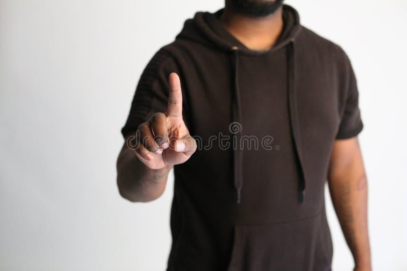 Человек указывая вверх с белой предпосылкой стоковая фотография rf