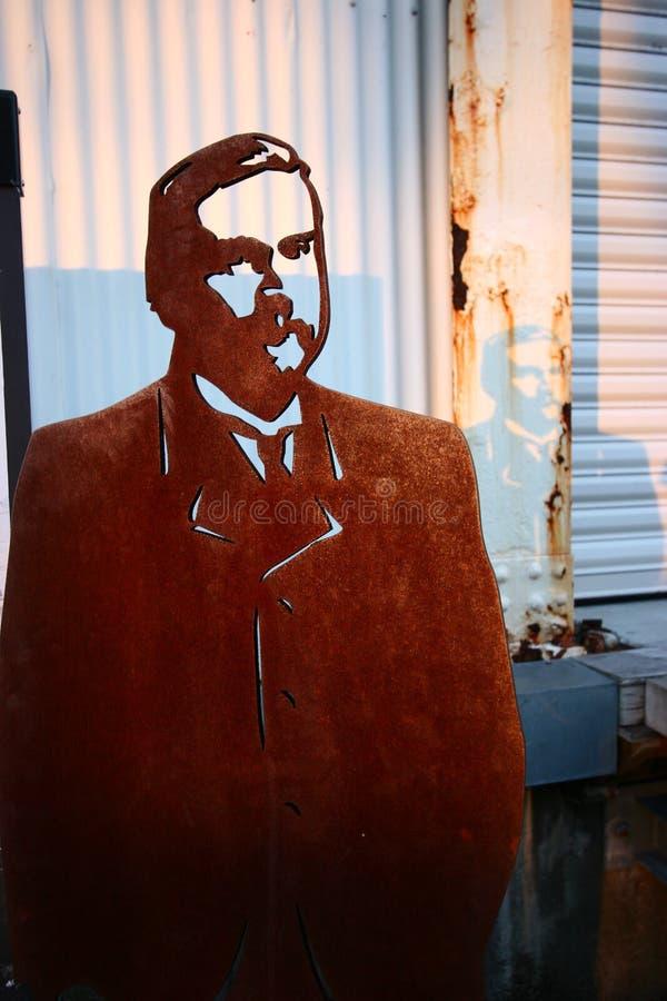 Человек Corten стальной отрезанный вне стоковые изображения rf