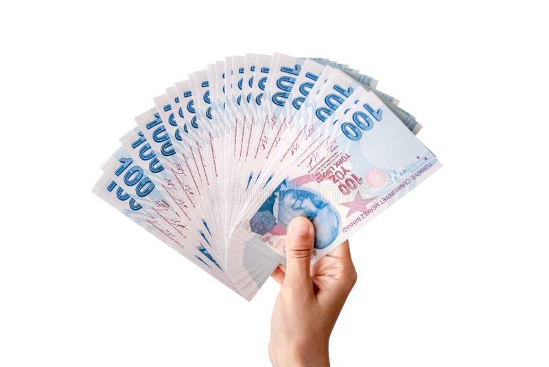 Человеческая рука держа турецкие деньги r стоковые изображения