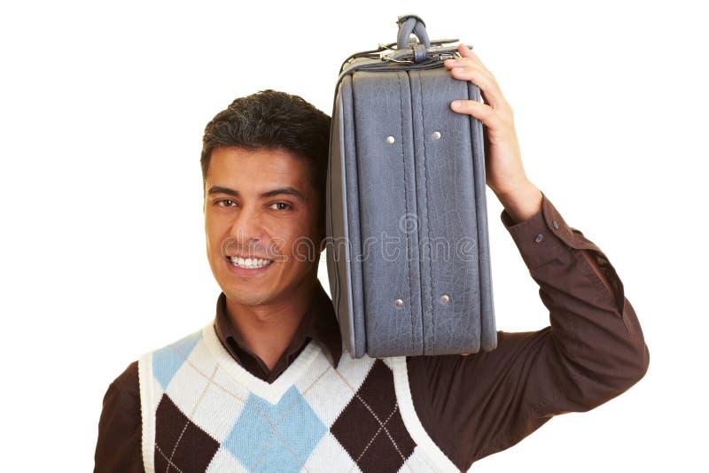 чемодан нося стоковое изображение rf