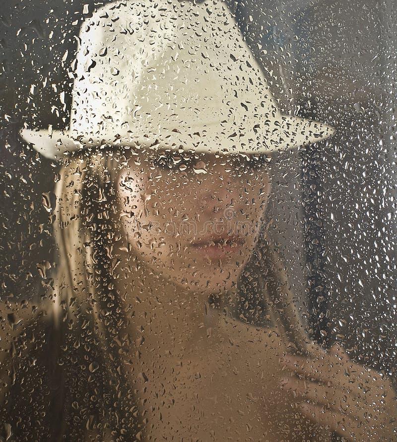 Через окно стоковое фото