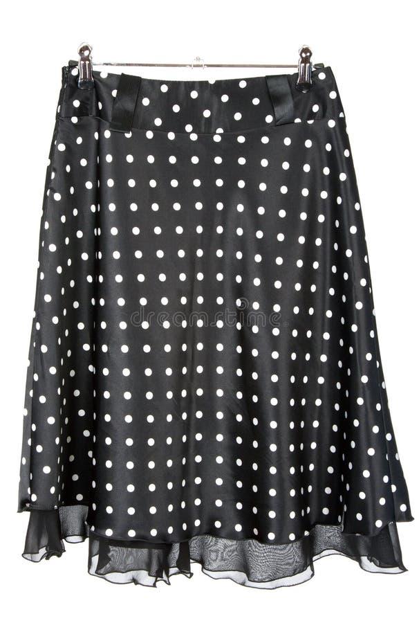 черная женственная юбка сатинировки стоковые фотографии rf
