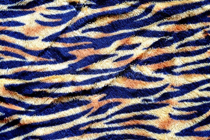 Черная и желтая нашивка тигра на ткани стоковые изображения rf