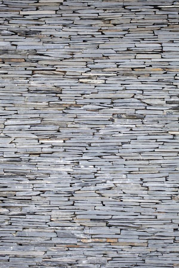 Черная каменная стена, текстура предпосылки стоковое изображение