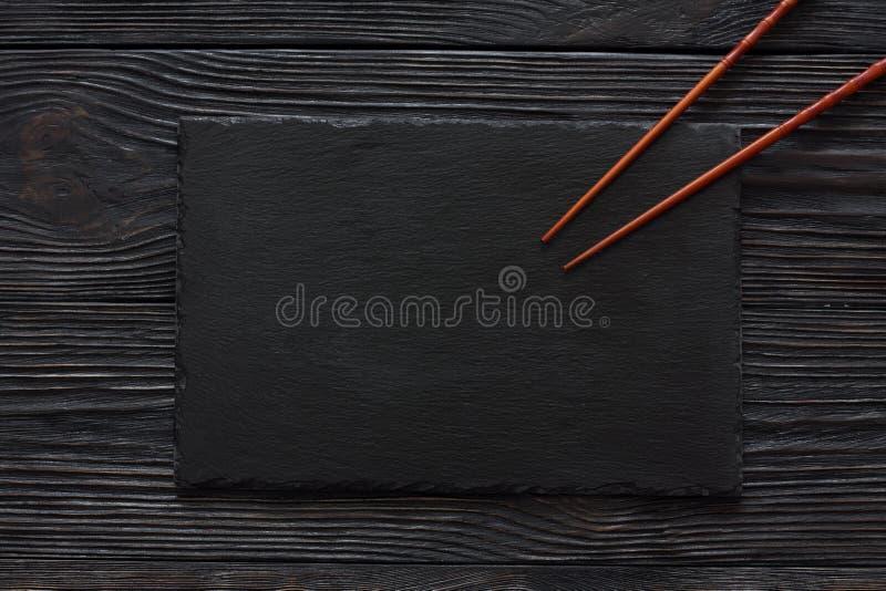Черная каменная текстура предпосылки шифера стоковые фото