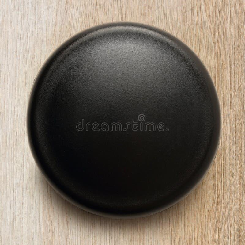 Черная кнопка на белой предпосылке стоковое фото rf