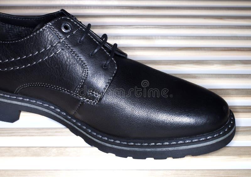 черная кожа ботинка стоковая фотография