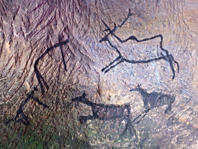 Черная краска углерода человеческого звероловства на стене песчаника, стоковое изображение rf